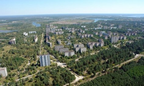 The deserted city of Pripyat. Pripyat was home to the workers of Chernobyl and their families (approximately 50 000 people). It's now a nuclear ghost town. The Chernobyl nuclear power station is in the background.